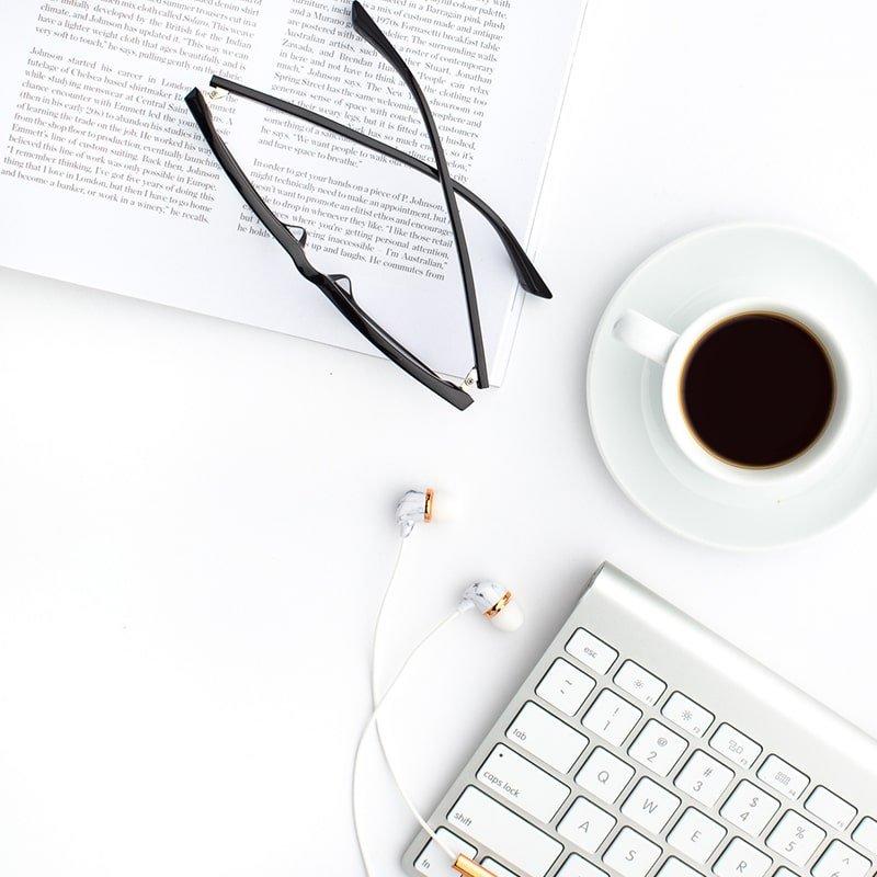 Pollyanna Consulting | Keyboard + Coffee + Book